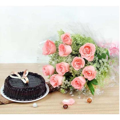 Tempting combo of fresh cake and pink roses